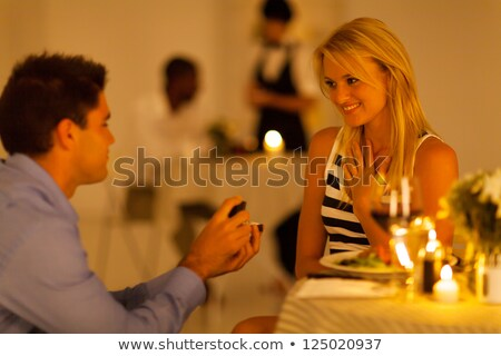 Man proposing a woman with a ring on his knee in the restaurant Stock photo © wavebreak_media