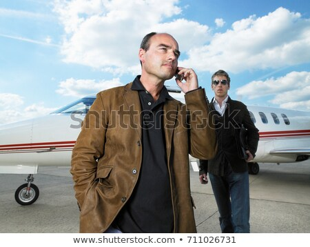 Two men beside private jet. Stock photo © IS2