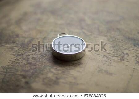 blue nautical compass closeup focus on east stock photo © lunamarina