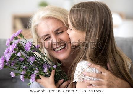 parents · baiser · fille · mère · père · souriant - photo stock © dolgachov