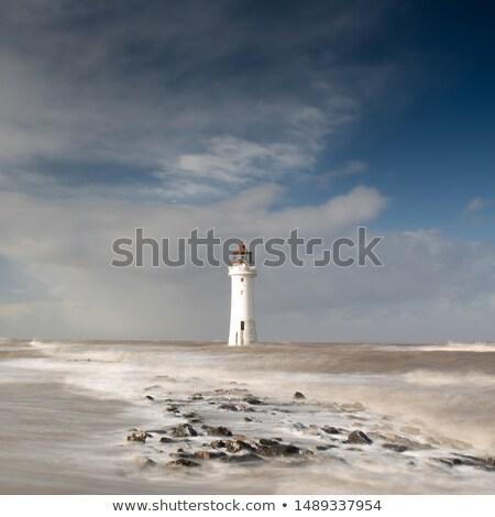 beautiful light in ocean surrounding coastal rocks in high tide stock photo © lovleah