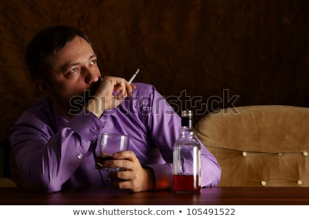 drunk man drinking alcohol and smoking cigarette stock photo © dolgachov