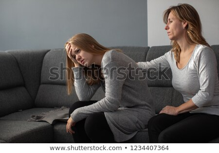 Depressed teen suffering from anxiety being taken care of by her mother Stock photo © lightpoet