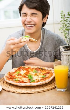 Teen boy enjoying pizza and juice Stock photo © Anna_Om