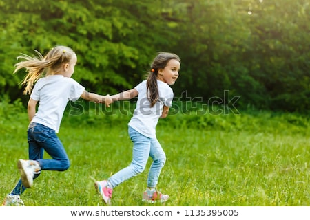 summer childhood leisure and people concept happy little girl running stock photo © lopolo