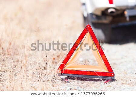 closeup shot of the red emergency stop sign and broken white car stock photo © nobilior