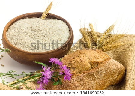 Wheat grains in white ceramic bowl on sackcloth background Stock photo © Melnyk