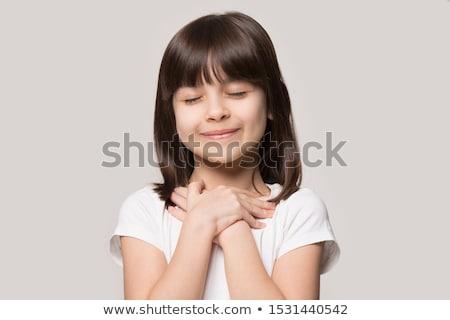 Kid Mädchen Hand Brust Lob farbenreich Stock foto © lenm