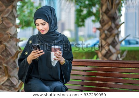 Happy young muslim businesswoman in hijab and formalwear Stock photo © pressmaster