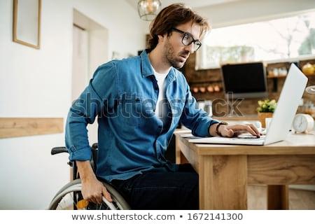 инвалидов бизнесмен рабочих ноутбука вид сзади партнера Сток-фото © AndreyPopov