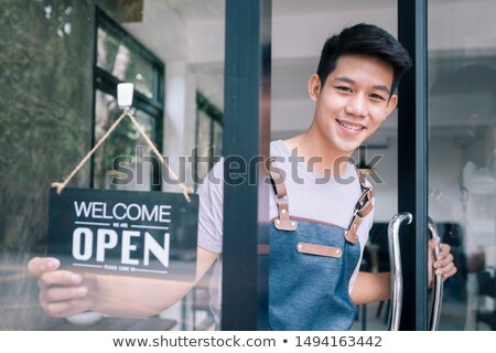Young startup coffee cafe owener open and welcome customer.  Stock photo © ijeab