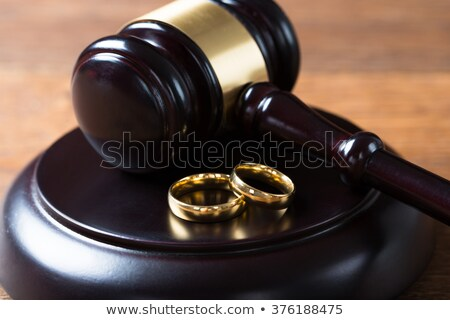 wedding rings and mallet on wooden desk in courtroom stock photo © andreypopov