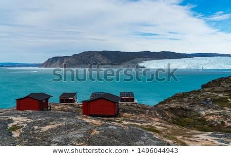 Greenland glacier nature landscape with famous Eqi glacier and lodge cabins Stock photo © Maridav