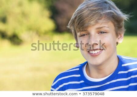 Jonge gelukkig glimlachend mannelijke jongen tiener Stockfoto © Lopolo