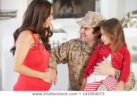 Daughter Hugging Military Father Home On Leave Stock photo © HighwayStarz