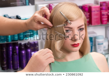 Happy young professional hairdresser with hairbrush and hairdryer Stock photo © pressmaster