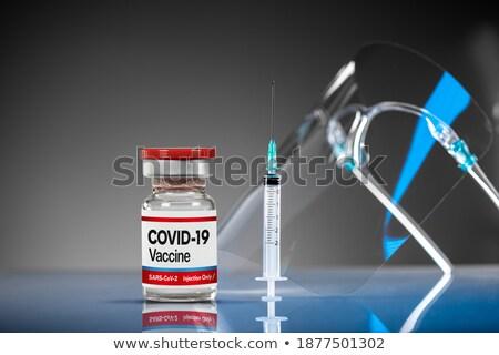 Koronavírus vakcina fiola injekciós tű tükröződő fehér Stock fotó © feverpitch
