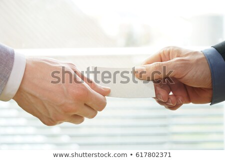 business person gives visiting card Stock photo © goryhater
