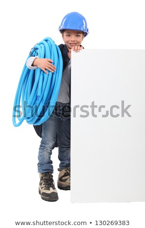 Young boy pretending to be a plumber with a board left blank for your message Stock photo © photography33