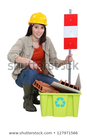 Female construction worker warning you to recycle old material Stock photo © photography33