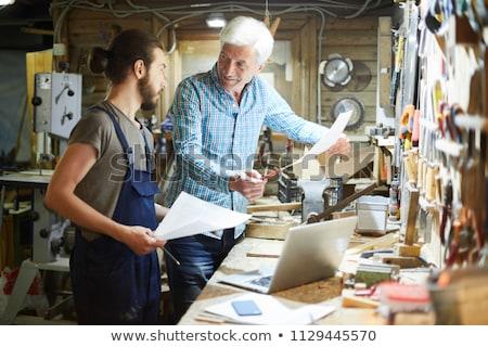 Handyman estagiário sorrir trabalhar indústria trabalhador Foto stock © photography33