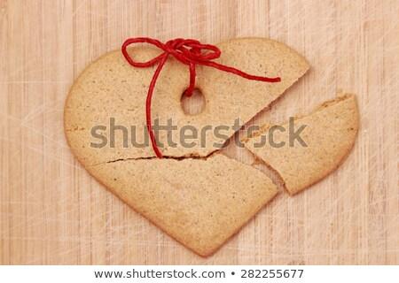 Stok fotoğraf: Broken Heart Cake On Wooden Table