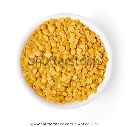 bowl with yellow lentils stock photo © zerbor