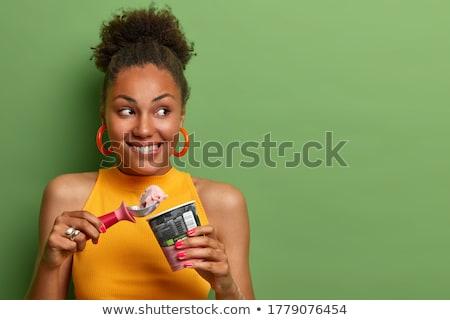 Blij jonge vrouw eten dessert vruchten vrouw Stockfoto © konradbak