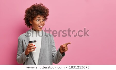 Stock photo: Attractive business lady indicating away