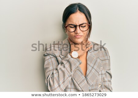 young brunette business woman with glasses pain in neck stock photo © sebastiangauert