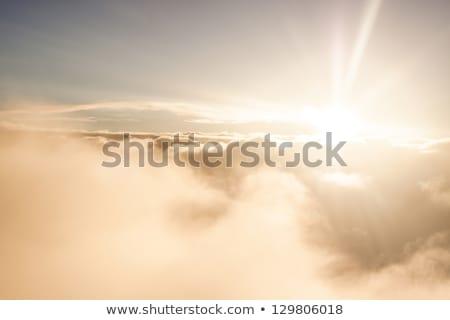 napfelkelte · fölött · felhők · arany · digitális · mű - stock fotó © stockyimages