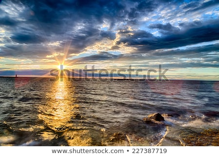 Sunset view from the shore with breakwaters Stock photo © shihina