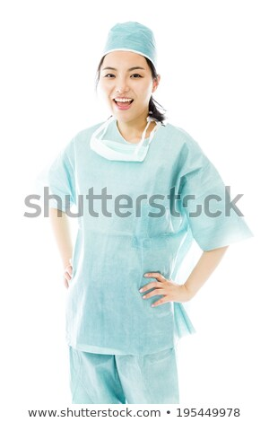 confident asian female surgeon standing with arms akimbo stock photo © bmonteny