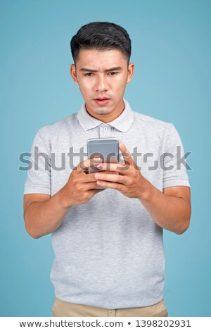 worried young man with open arms stock photo © alexandrenunes