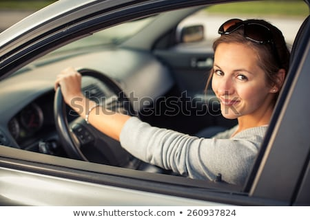 driving a car at night   pretty young woman driving her car stock photo © lightpoet