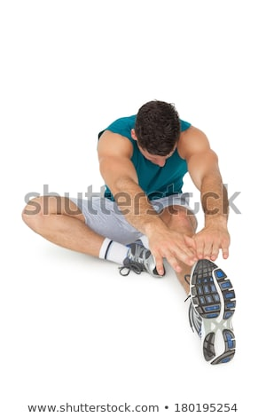 Sports man doing physical exercise for stretching over white background Stock photo © deandrobot