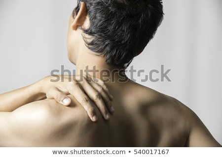 portrait of a muscular man with neck pain stock photo © deandrobot