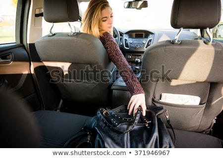 rear view of woman carring bag stock photo © filipw