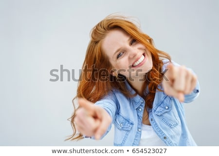 smiling young woman pointing finger on you Stock photo © dolgachov