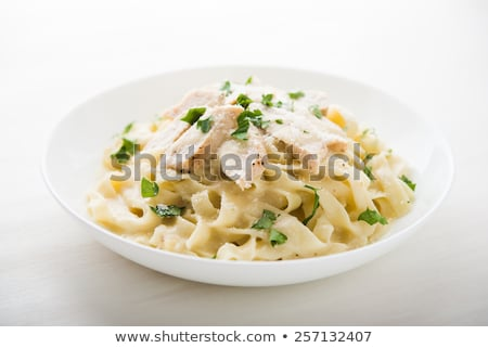 Pasta and chicken meat in cream sauce Stock photo © Digifoodstock