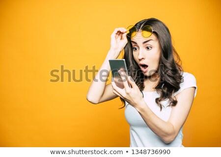 Néz nő pózol hát kamerába izolált Stock fotó © hsfelix