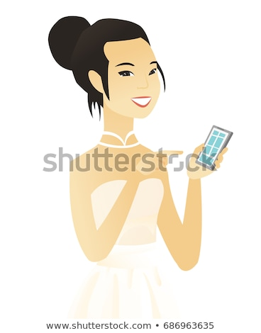 Young asian fiancee holding a mobile phone. Stock photo © RAStudio