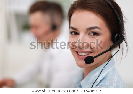 a telephone operator smiling to camera stock photo © is2