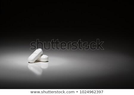 Hydrocodone Prescription Pills Under Spot Light. Stock photo © feverpitch