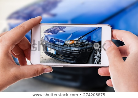 Woman and her damaged car Stock photo © Nobilior