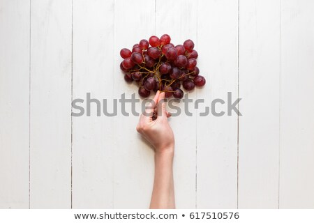 Woman holds branch of red grape Stock photo © boggy