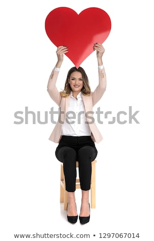 happy businesswoman holds red heart shape in the air Stock photo © feedough