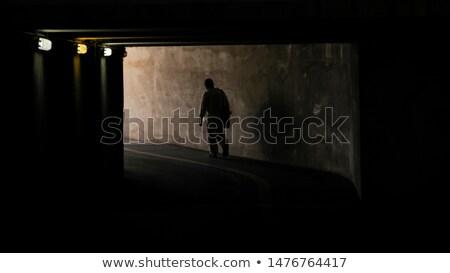 Homme marche lanterne sombre tunnel laide Photo stock © ra2studio