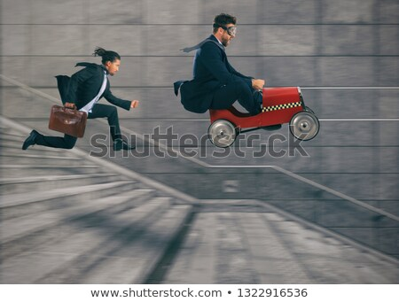 Reckless business man races with a car to win a competition against the competitors. Concept of succ Stock photo © alphaspirit