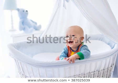 Little baby in crib smiling Stock photo © colematt